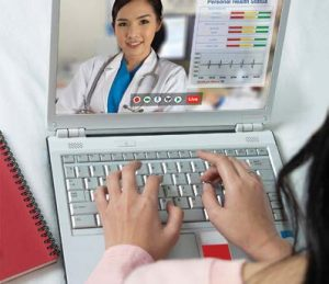 Woman on laptop to chat with Doctor